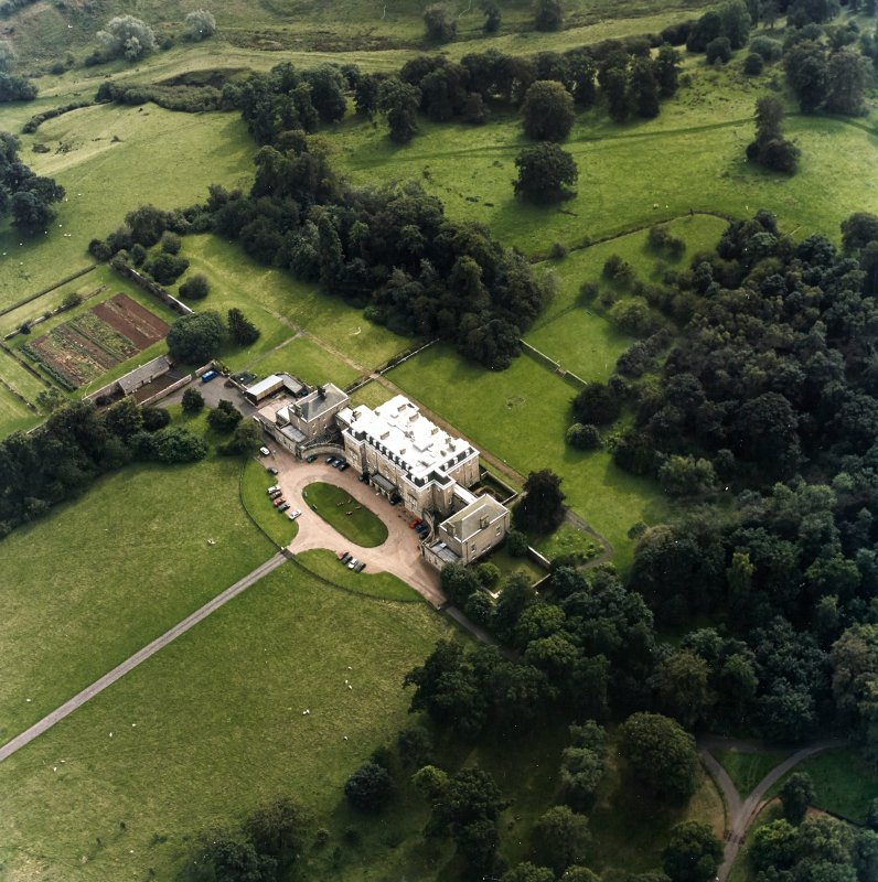 Oblique aerial view centred on the country house with walled garden adjacent, taken from the N.