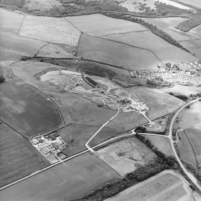Oblique aerial view centred on the quarry, taken from the SE.