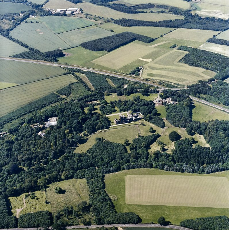 Oblique aerial view centred on the country house, with the farmsteading and burial ground adjacent, taken from the SSE.