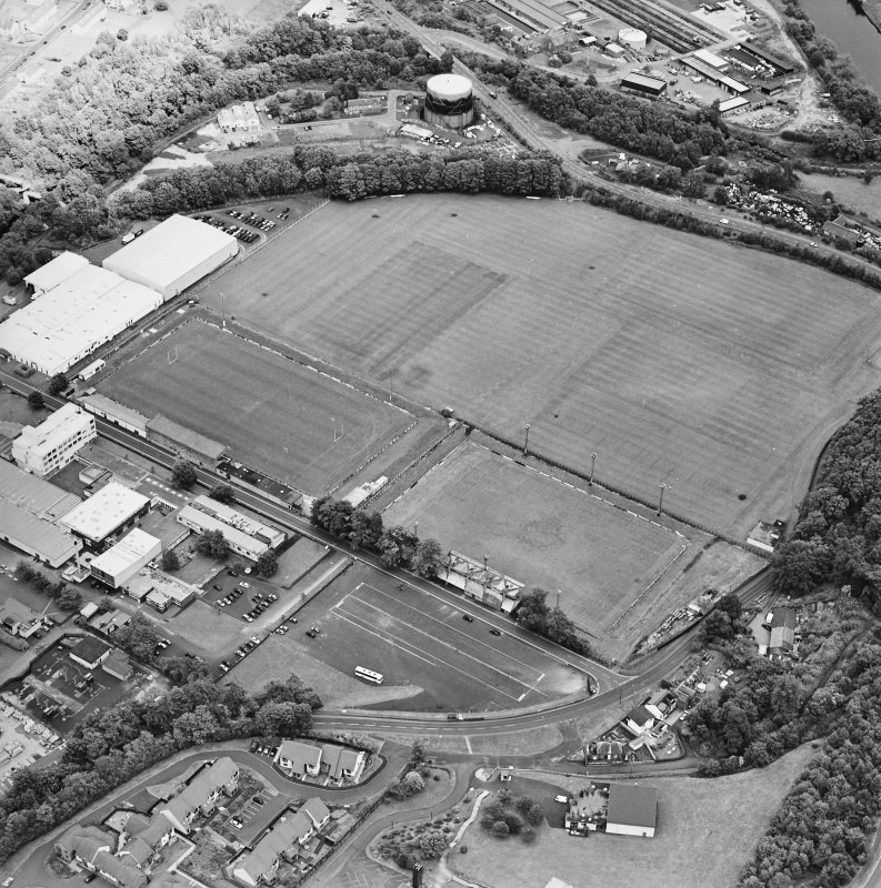 Oblique aerial view from the W, centred on the football and rugby grounds.  Gasworks are visible in the top half of the photograph.