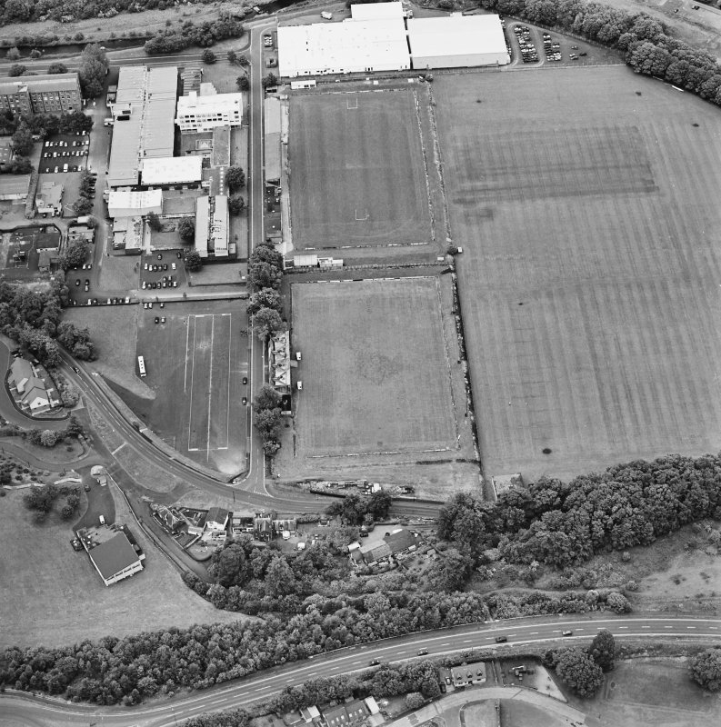 Galashiels, oblique aerial view, taken from the SW, centred on the football and rugby grounds.