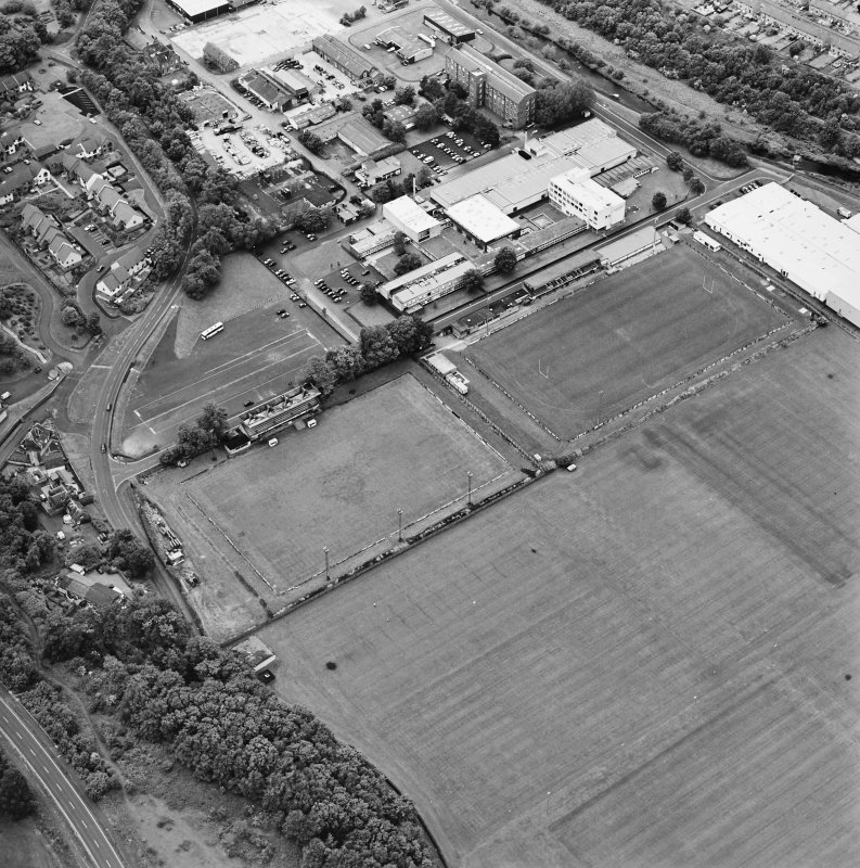 Galashiels, oblique aerial view, taken from the SE, centred on the football and rugby grounds.