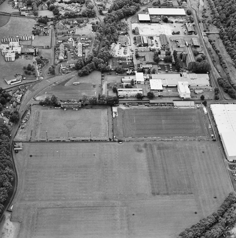 Galashiels, oblique aerial view, taken from the ESE, centred on the football and rugby grounds.