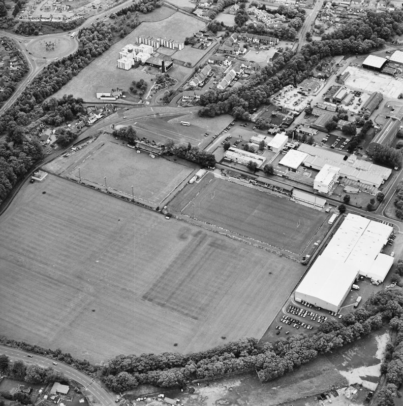 Galashiels, oblique aerial view, taken from the E, centred on the football and rugby grounds.