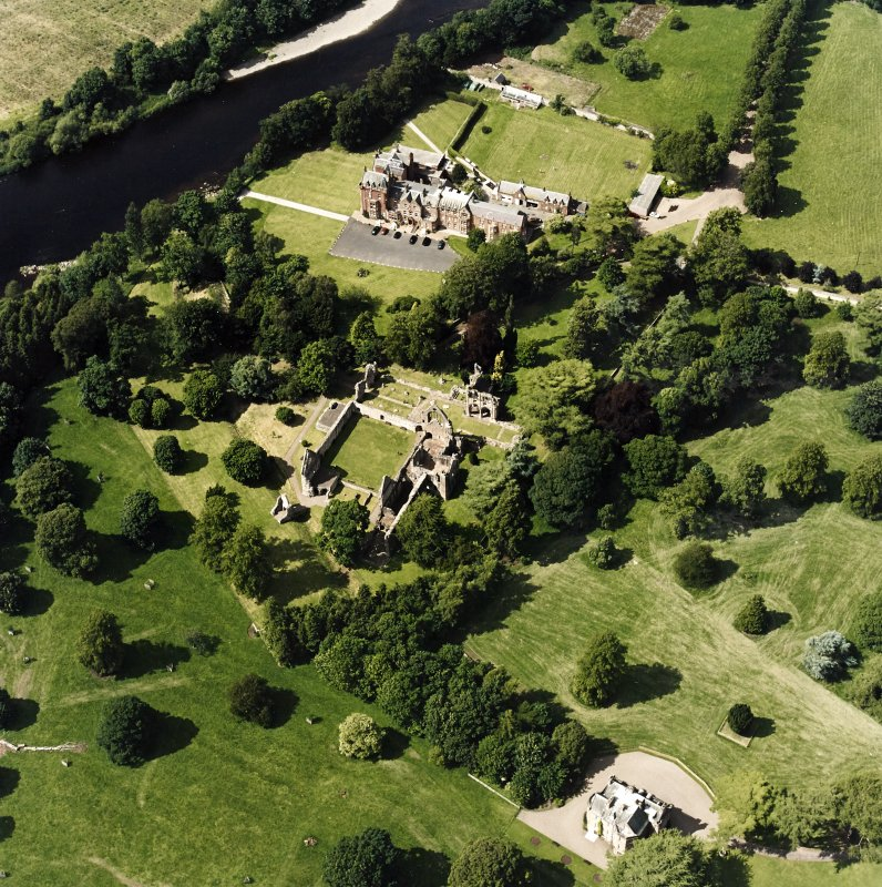 Dryburgh Abbey, oblique aerial view, taken from the SE, centred on the abbey, with Dryburgh House Hotel in the top of the photograph.