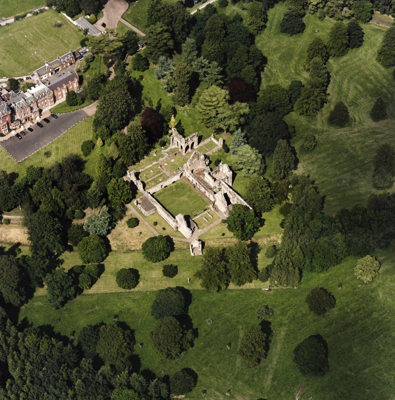 Dryburgh Abbey, oblique aerial view, taken from the SW, centred on the abbey, with Dryburgh House Hotel in the top left-hand corner.