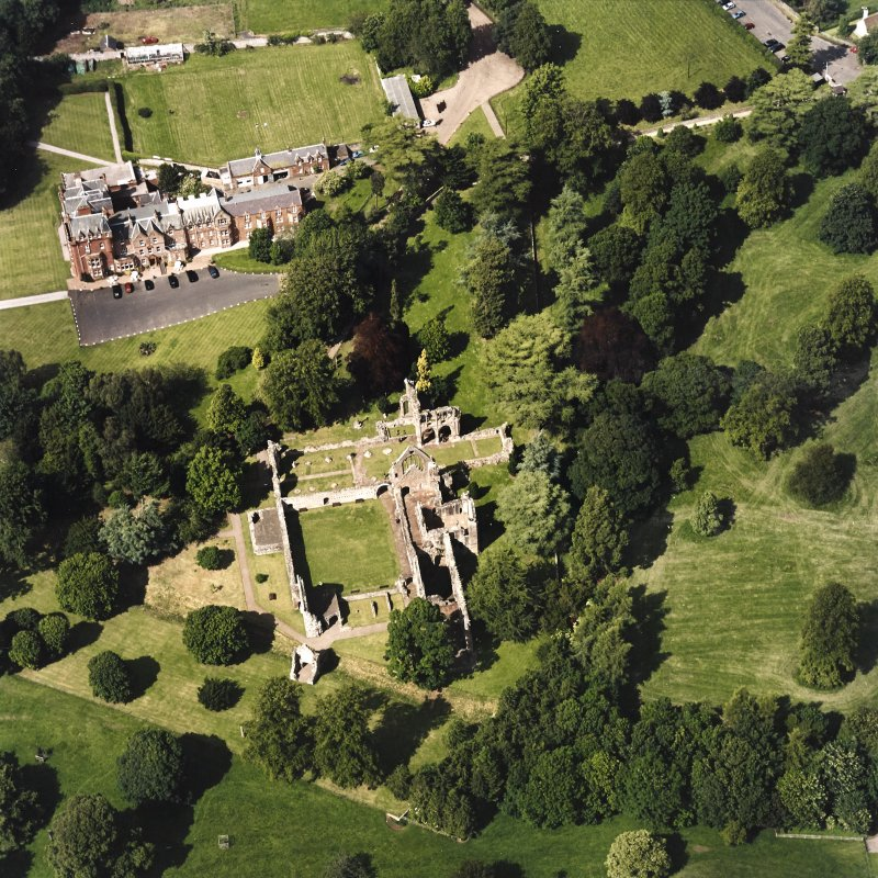 Dryburgh Abbey, oblique aerial view, taken from the SSW, centred on the abbey, with Dryburgh House Hotel in the top left-hand corner.