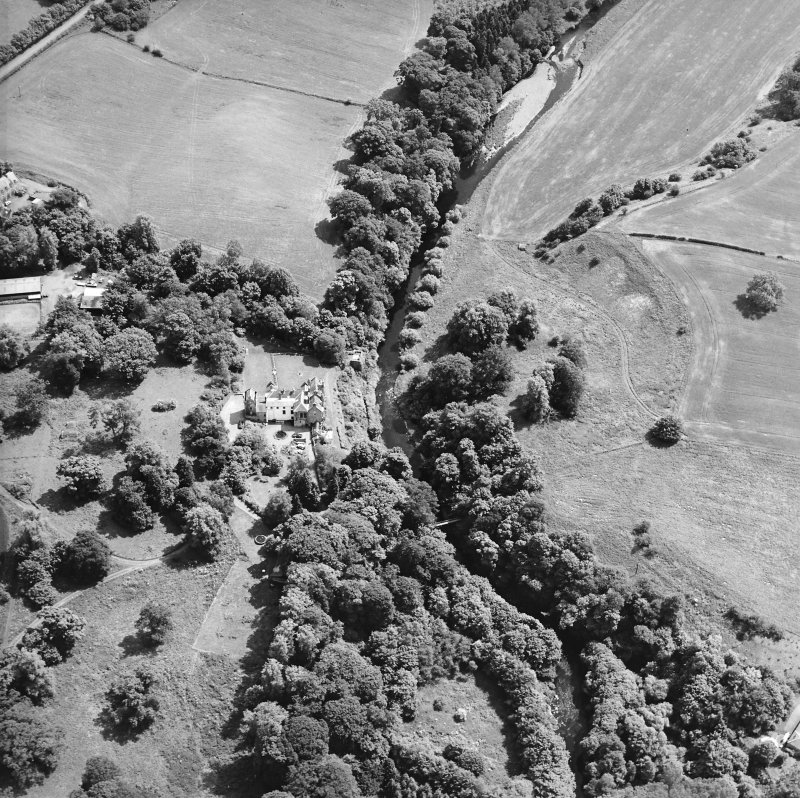Oblique aerial view centred on the castle, tower-house and country house with the tower and walled garden adjacent, taken from the NNW.