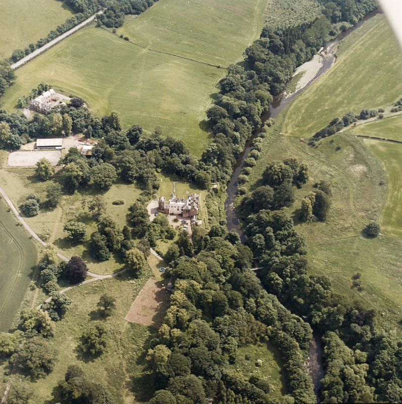Oblique aerial view centred on the castle, tower-house and country house with the stables, tower and walled garden adjacent, taken from the NW.