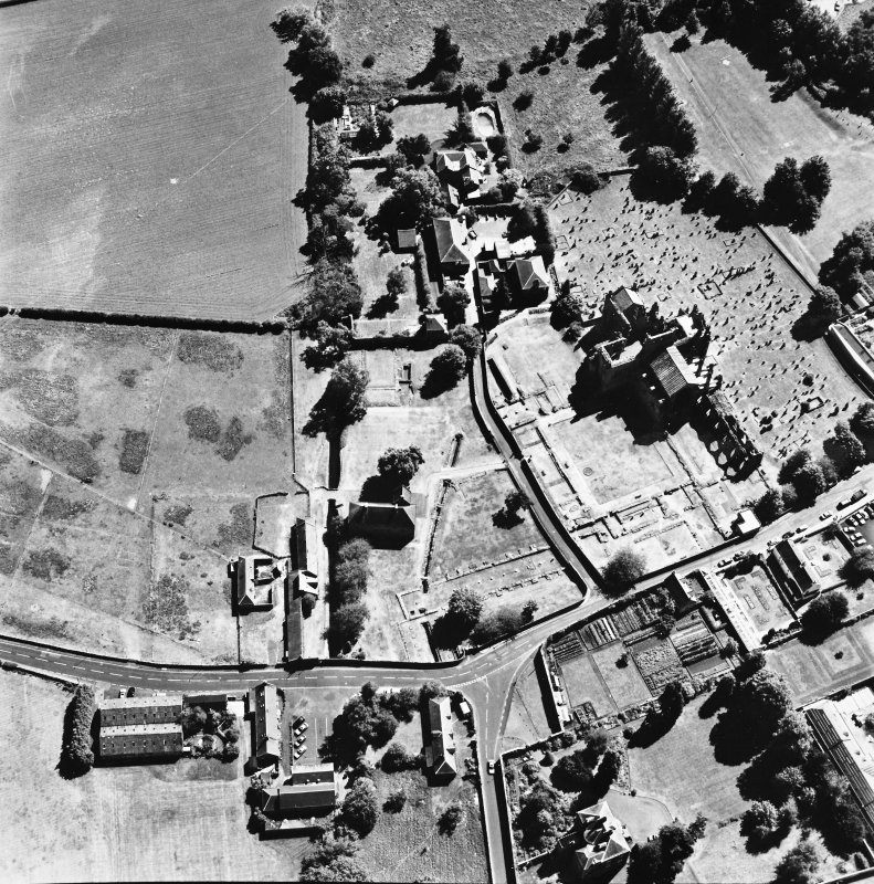 Oblique aerial view from the NW centred on the remains of the Abbey.