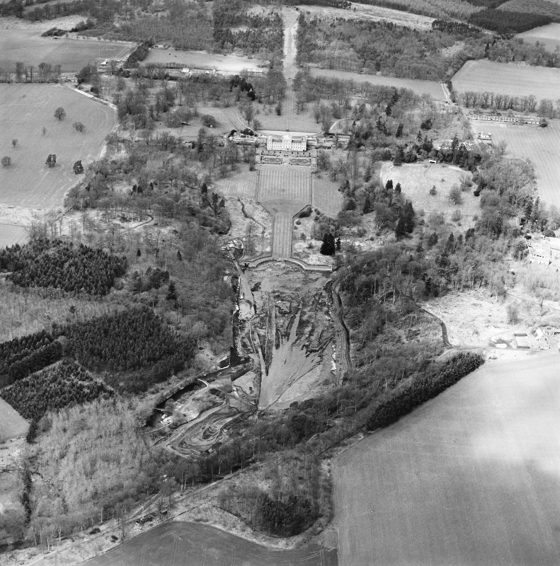 Oblique aerial view centred on the drained formal pond within Mellerstain House garden with country house and stables adjacent, taken from the SE.
