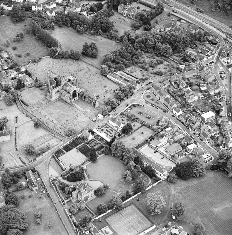 General oblique aerial view centred on Harmony house and the remains of the abbey, taken from the NW.