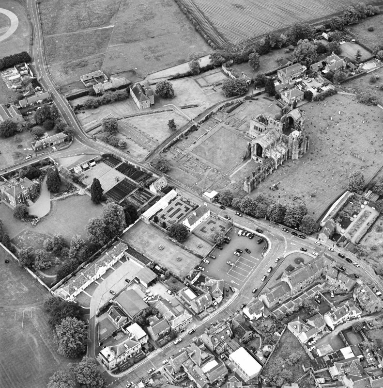 General oblique aerial view centred on Harmony house and the remains of the abbey, taken from the SW.
