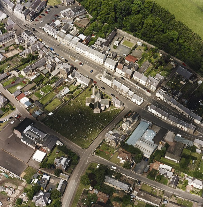 Oblique aerial view centred on St. Mary's church, taken from the S.