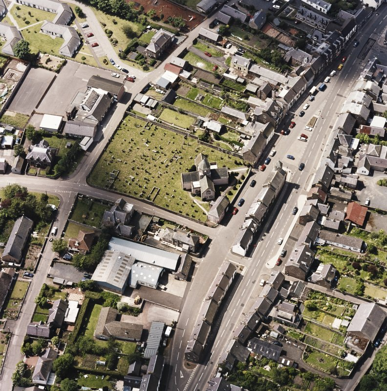 Oblique aerial view centred on St. Mary's church, taken from the E.