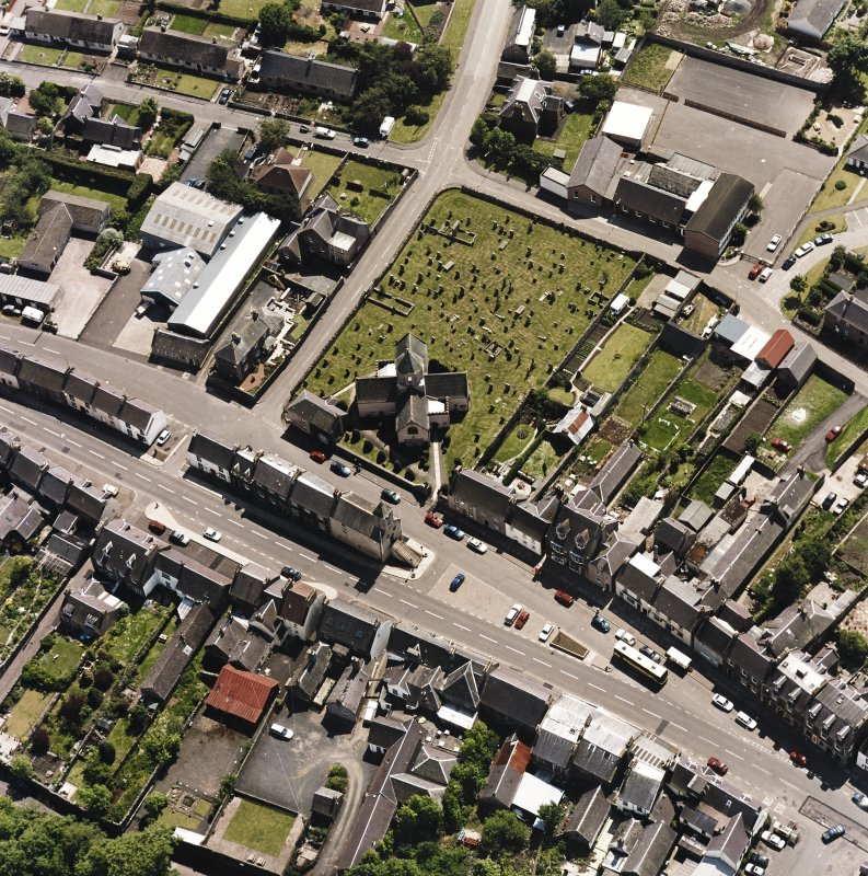 Oblique aerial view centred on St. Mary's church, taken from the N.