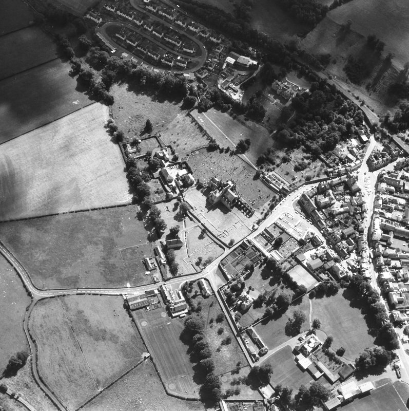 Oblique aerial view centred on abbey from NW.