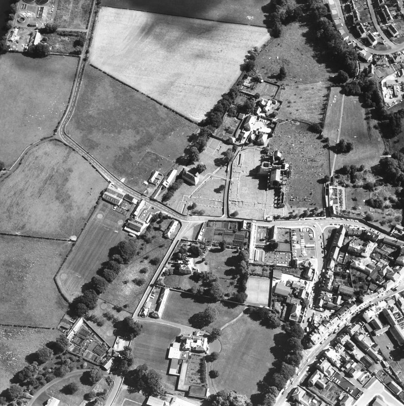 Oblique aerial view centred on abbey from W.