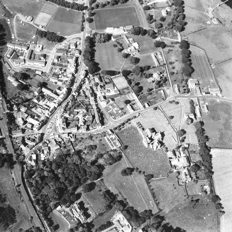 Oblique aerial view centred on abbey from SE.