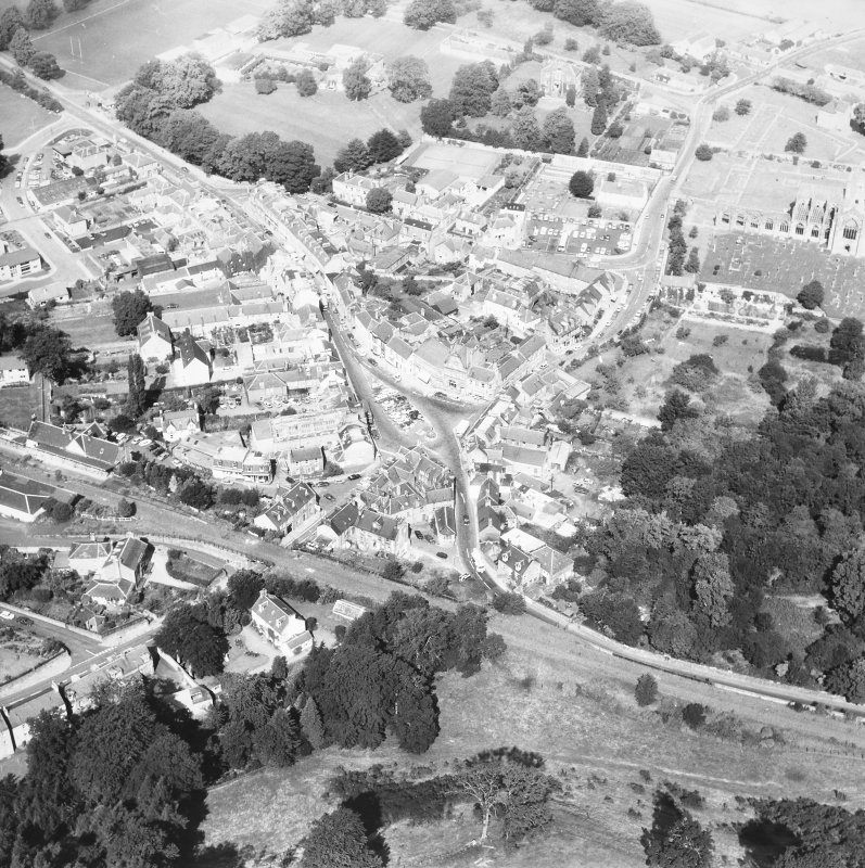 Oblique aerial view centred on town from S.
