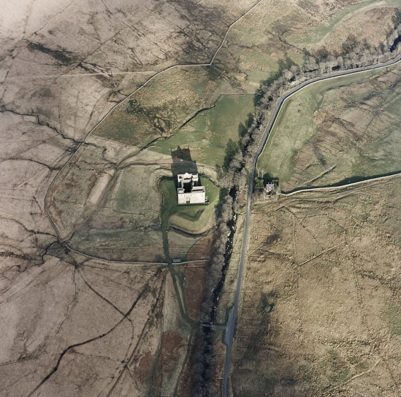 Oblique aerial view centred on the remains of the castle, taken from the WSW.