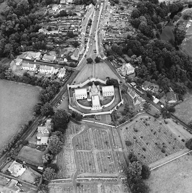 Oblique aerial view centred on the jail, burial ground and The Hermitage, taken from the SW.
