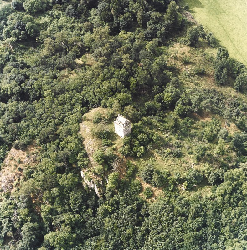 Oblique aerial view centred on the remains of the tower-house, taken from the ESE.