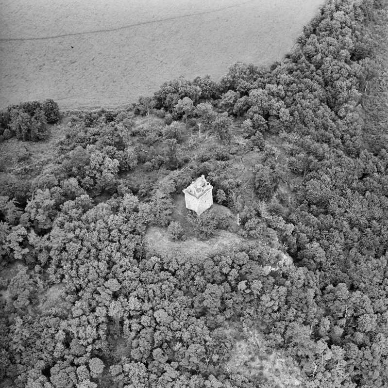Oblique aerial view centred on the remains of the tower-house, taken from the SSW.