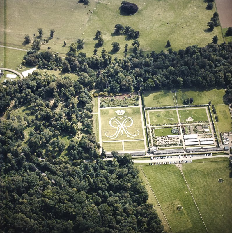 Oblique aerial view centred on the formal garden, taken from the NW.