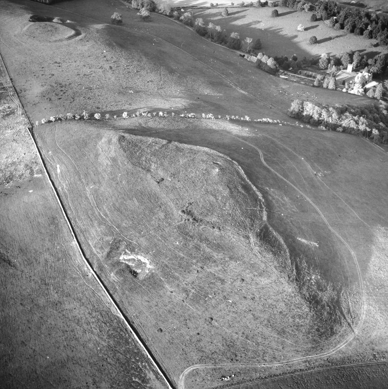 Oblique aerial view centred on forts from SW.