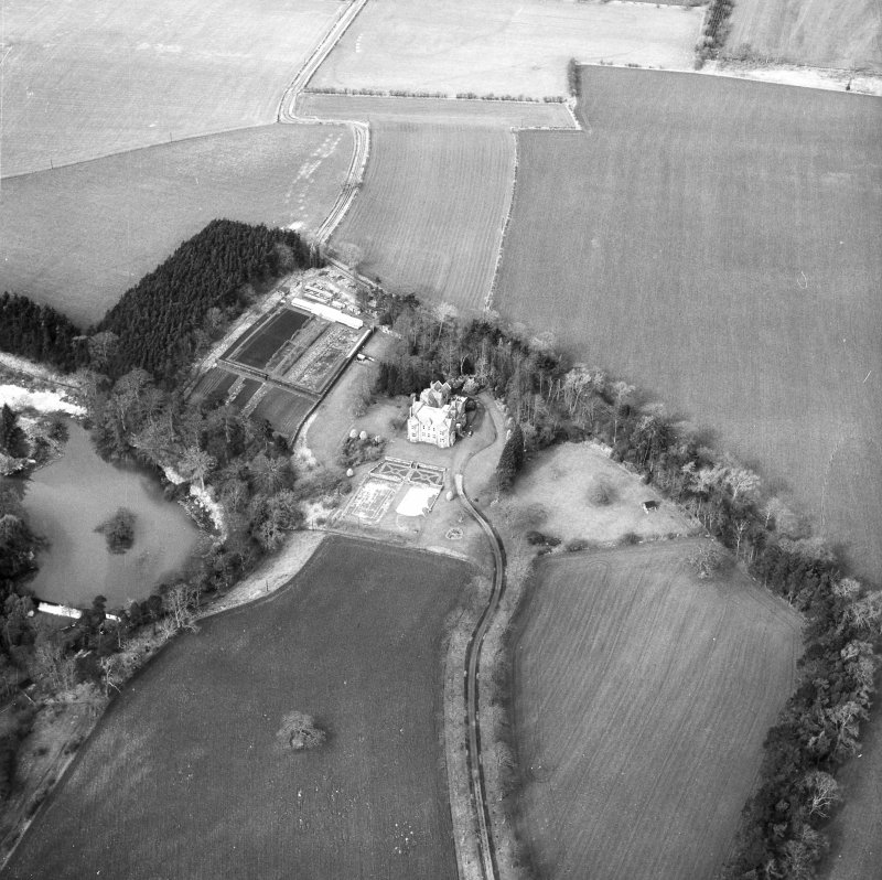 Oblique aerial view centred on country house from SSE.
