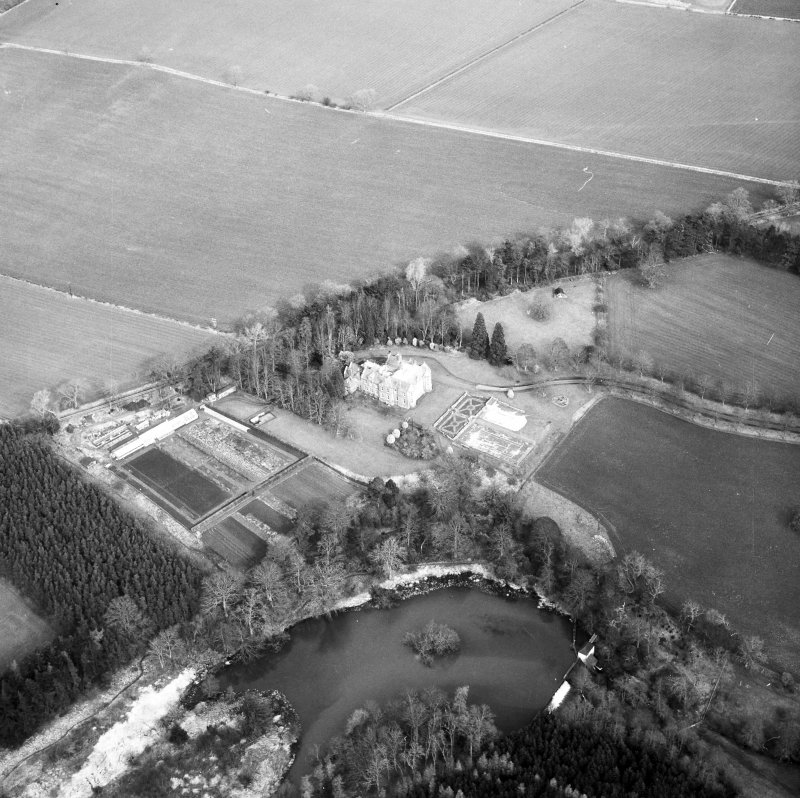 Oblique aerial view centred on country house from SSW.