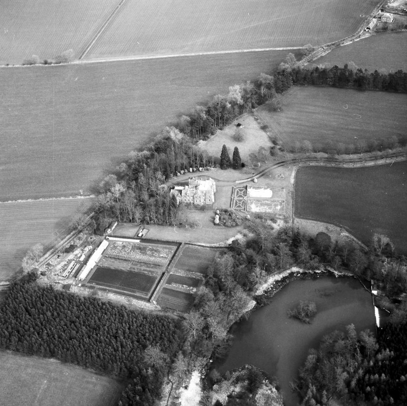 Oblique aerial view centred on country house from WSW.