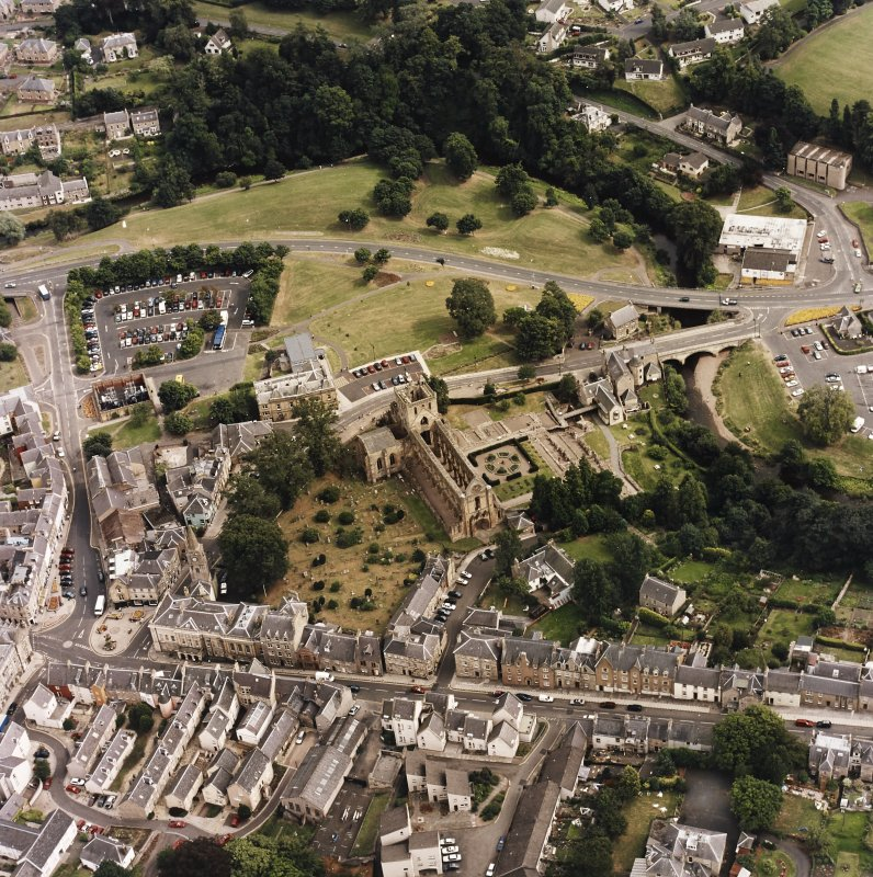 Oblique aerial view of Jedburgh centred on the abbey, taken from the WNW.