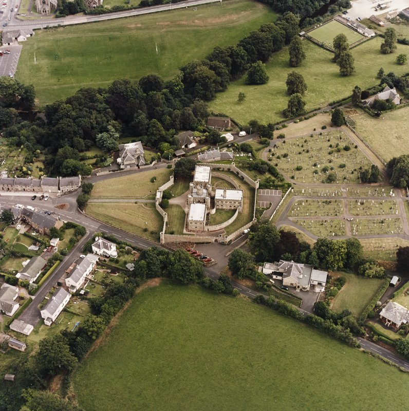 Oblique aerial view centred on the jail, burial ground and The Hermitage, taken from the WNW.