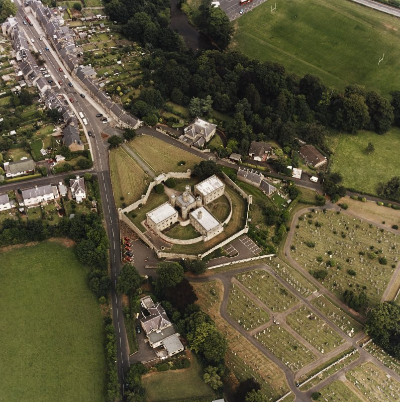 Oblique aerial view centred on the jail, burial ground and The Hermitage, taken from the WSW.