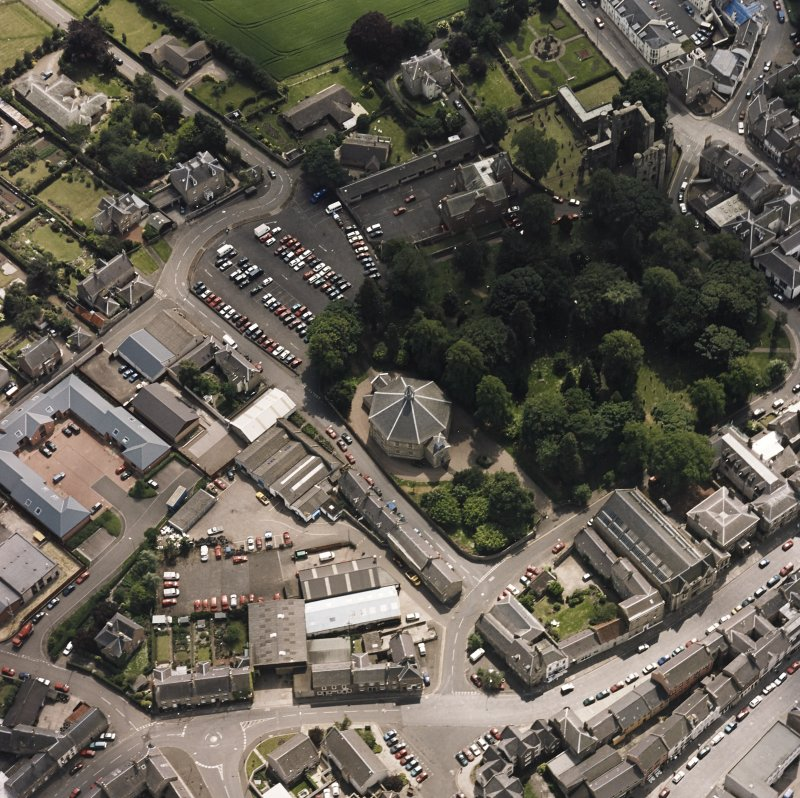 Oblique aerial view centred on the church, taken from the N.
