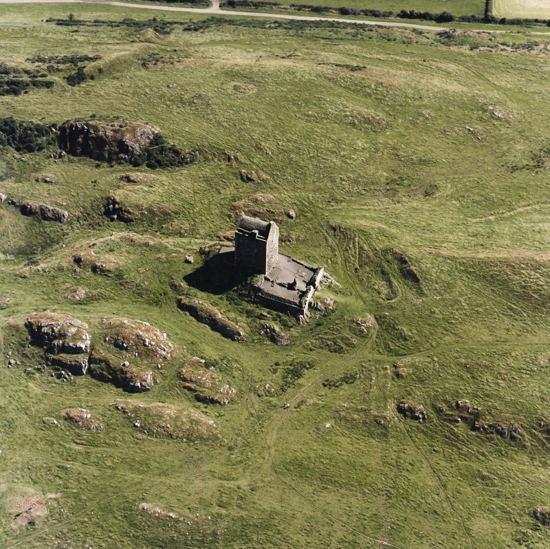 Oblique aerial view centred on the tower house, taken from the NW.