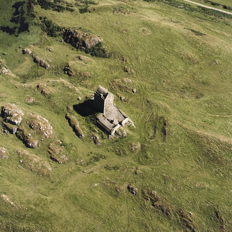 Oblique aerial view centred on the tower house, taken from the WNW.