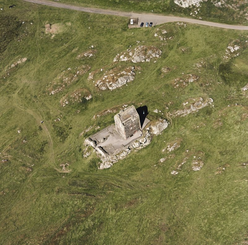 Oblique aerial view centred on the tower house, taken from the SW.