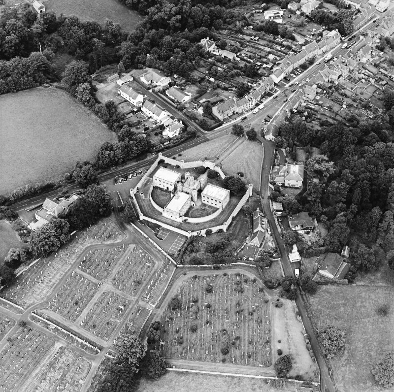 Oblique aerial view centred on the jail, burial ground and The Hermitage, taken from the S.