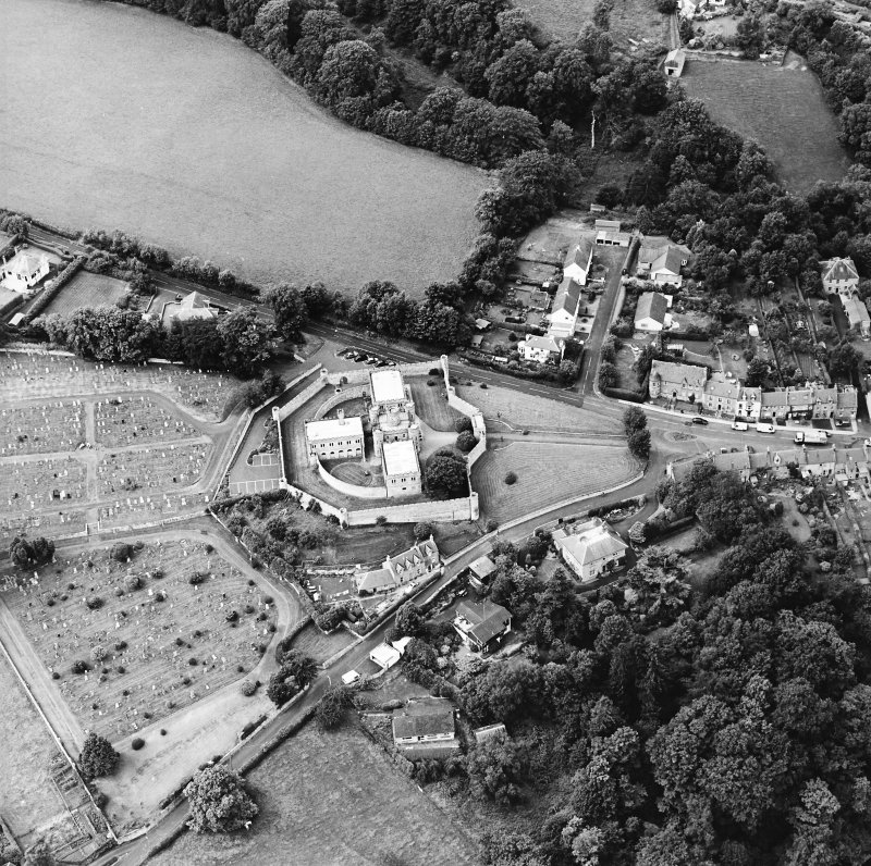 Oblique aerial view centred on the jail, burial ground and The Hermitage, taken from the ESE.