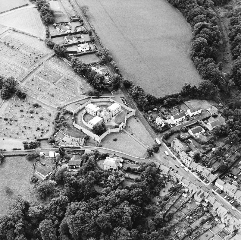 Oblique aerial view centred on the jail, burial ground and The Hermitage, taken from the ENE.