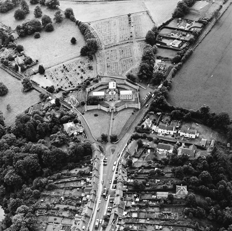 Oblique aerial view centred on the jail, burial ground and The Hermitage, taken from the NNE.