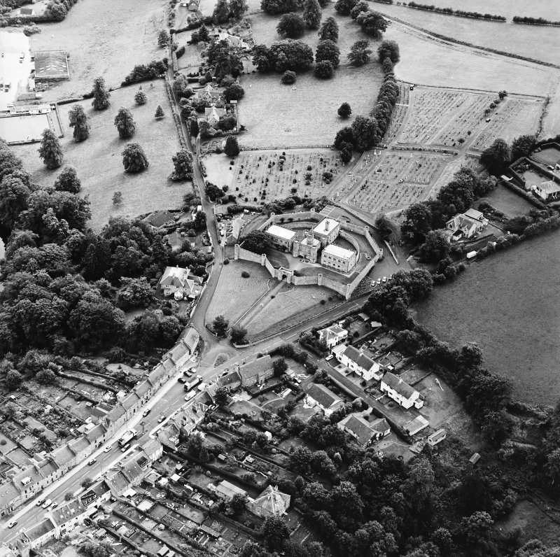 Oblique aerial view centred on the jail, burial ground and The Hermitage, taken from the NNW.