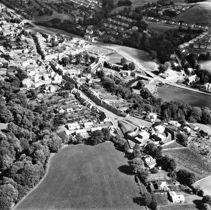 Oblique aerial view centred on abbey from SW.