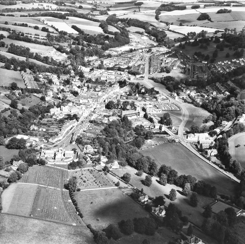 Oblique aerial view centred on abbey from SSW.