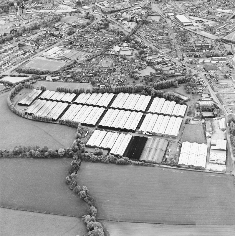 Oblique aerial view centred on the bonded stores of the Carsebridge Distillery, Alloa, taken from the E
