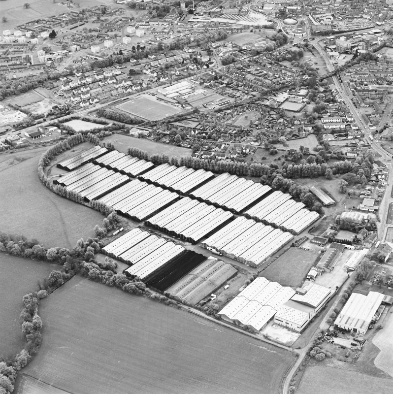 Oblique aerial view centred on the bonded stores of the Carsebridge Distillery, Alloa, taken from the ENE