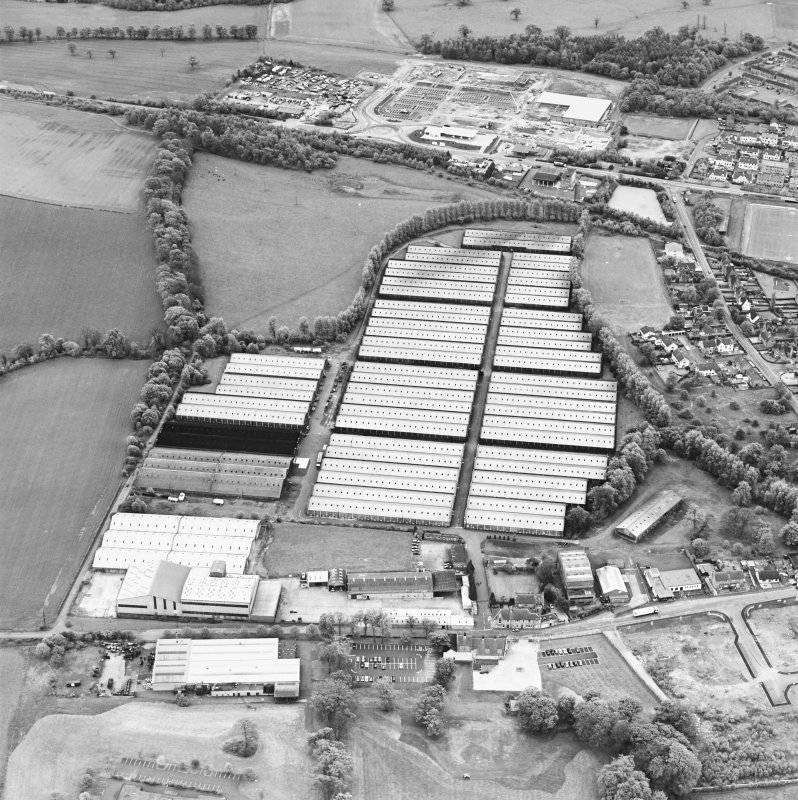 Oblique aerial view centred on the bonded stores of the Carsebridge Distillery, Alloa, taken from the N